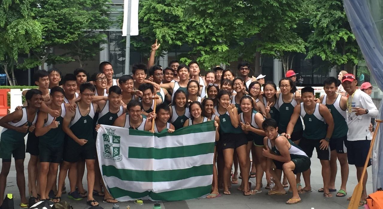The SJI dragon boat team posing for a photo in front of fans and supporters after triple medal haul!.JPG